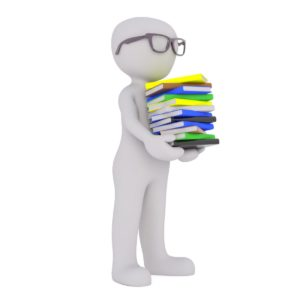 Model of a man with glasses holding books