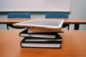 Books and ipad on desk